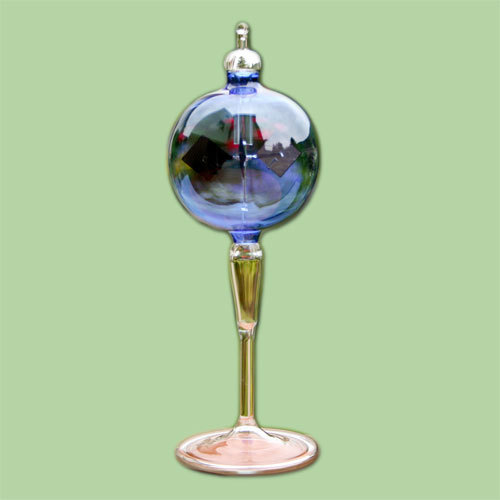 Radiometer with solid glass stem colored