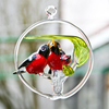 Bird family in a ring of glass