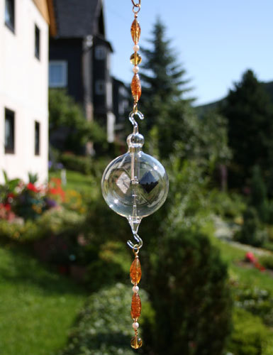 Radiometer with glass beads chain